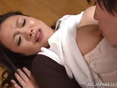After taking off her panties a Japanese cougar fucks a younger guy