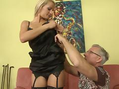 Porn star blonde in stockings gives her lover a great foot-job