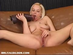 Solo model blonde with natural tits masturbating passionately using a toy