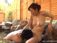 Lecherous Japanese cougar having her hairy pussy licked in reality shoot in the pool