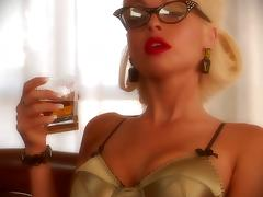 Blonde bombshell Jesse Jane, wearing glasses, plays with a dildo