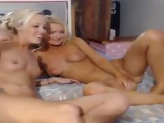 Two beautiful girls play together on cam