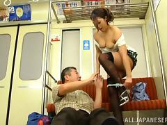 Aoi Miyama fingering her pussy on a public bus in stockings