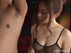 Japanese babe in fishnet attire giving her guy stunning blowjob
