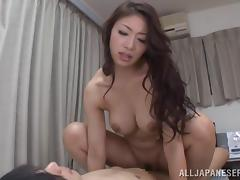 Alluring Japanese babe with natural tits enjoying a wild dick ride
