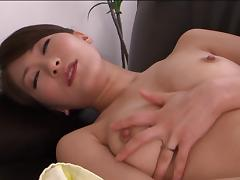 Affectionate Japanese solo model with natural tits masturbating close up