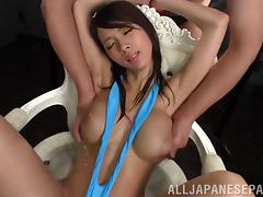 Pretty Asian chick with big natural tits getting her hairy pussy fingered