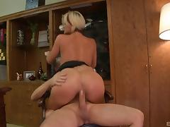 Pretty blonde porn star with a hot body enjoying a hardcore cowgirl style fuck
