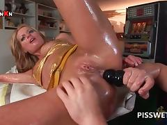 Wet slut gets ass fucked and dildoed for piss in close-up