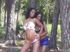 Horny ebony lesbian pussy lickers enjoying a hot forest sex action