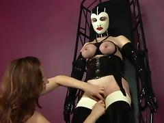 Sexy redhead teases slutty masked chick