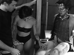 A crazy tattooed MILF gets fucked by Frankenstein and another guy