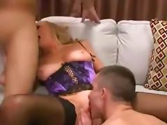 Nasty cougar gets a facial after threesome sex