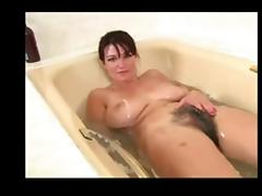 Very hairy babe plays in the bath