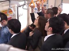 A very daring Japanese babe sucks a guy's cock on a crowded subway