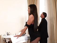 Stunning long haired brunette gets her nice ass oiled then penetrated doggy style