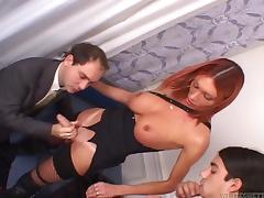 Dainty redhead shemale with big tits screwing her guy doggy style in a savory threesome
