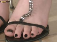 An amateur girl showing off her feet and playing with her toes