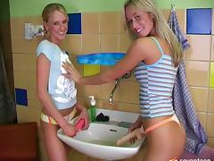In the bathroom during a party two lesbian teens strip and fuck
