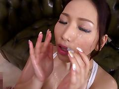 Beautiful Japanese babe gets a facial cumshot and loves it