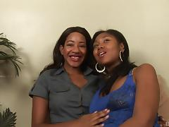 Kinky ebony lesbians banging with a strap on in a homemade tape