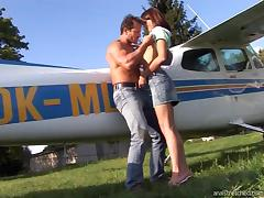 Pilot and a pretty girl get out of the plane and fuck in the grass