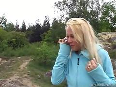 Sexy blonde in a hoodie jerks off your cock and flashes her tits