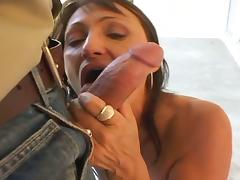 Brunette milf with a nice body sucks his cock before fucking