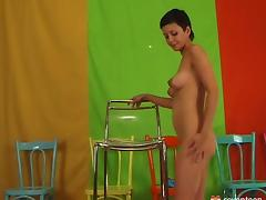 Short haired bombshell dildoes herself on a transparent chair