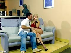 Blonde does a split on his cock and rides him to orgasm