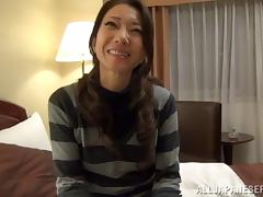 Japanese milf vibrates his cock before using it on her pussy