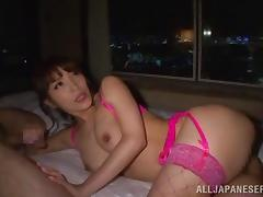 Double teaming a hot Japanese slut in pink fishnets