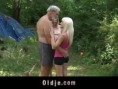 Two wild babes invite an older man to a threesome in the forest