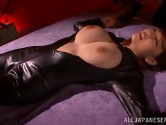 Busty Japanese babe in black latex fucks her slave