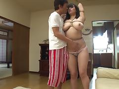 A curvy Japanese girl gets laid down and her big tits fucked