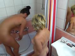 Mature lesbian sex dolls drilling their cunts with toys in the bathroom