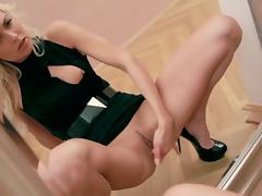 Blonde babe Lena G. masturbates on a boring exhibition