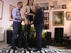 Tall British babe in sexy latex boots enjoys two dicks