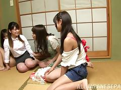 Girls in skirts have a Japanese lesbian party with cunt eating