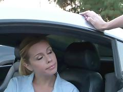 Stunning young blondes fuck in a sports car outdoors