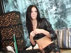 A babe in leather strips down and fucks her vibrator