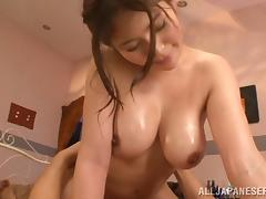 Oiled-up Asian whore with great juggs getting her wet pussy fingered