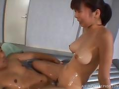 Asian masseuse delivers an oily massage with a happy ending