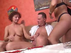 Chubby cougar with short dark hair enjoying a hardcore threesome