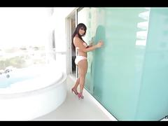 Latina shemale shows off her smooth body and plays with her dick