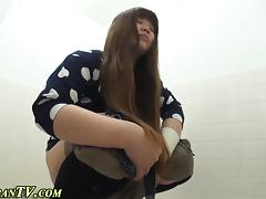 Asian sluts pee in toilet