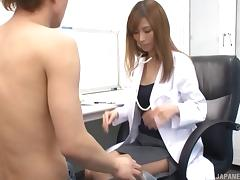 A sexy Asian doctor sprawls out on the desk and gets fucked