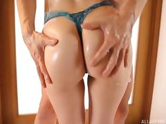 Rubbing thick and sticky goo all over her Japanese body