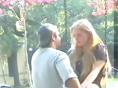 Blonde's kissing a guy on a public street