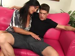 A naughty MILF fucks her son's best friend and sucks his dick